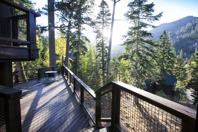 Trapper Mc Nutt  Modern Mountain Home - a SkyRun North Tahoe Property - Back Deck (alt view) - Wide open picturesque views from this spacious deck!