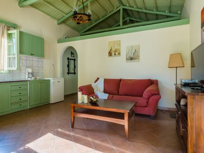 Photo for Neptune Cottage nestles amidst olive groves, just two minutes from  Lefto Yialo