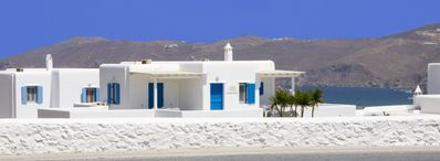 Exterior of Blue Cactus Villas with view of Ftelia Beach