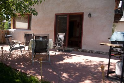 Private back porch and grilling area outside studio