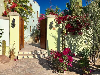 Cactus and bougainvillea greet you as you come through the wood doors.