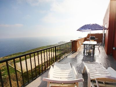 Photo for Cliff Edge Views - amazing location - high above the sea with large balcony. BBQ