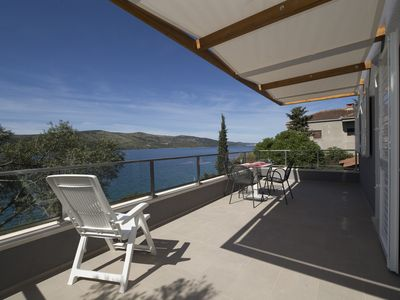 Photo for Luxury Beachfront Villa with 3 bedrooms and private garden and outdoor kitchen