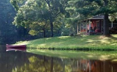 Photo for Private, pet friendly lake...secluded and 1 mile to Main St ... perfect location