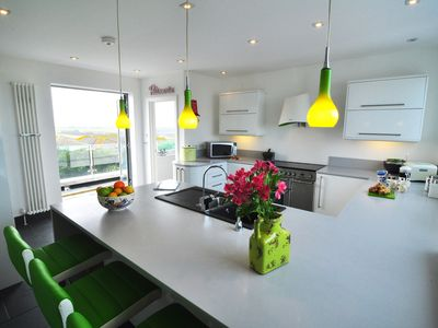 Photo for 3 Bedroom modern house with garden, parking & incredible beach & sea views