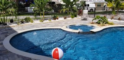 New sparkling heated saltwater pool with spa, sun deck & bubbler.