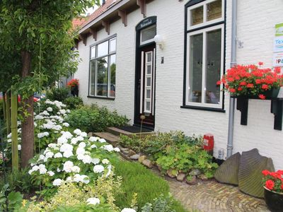 Photo for Stylish apartment with garden in a former farmhouse in De Waal