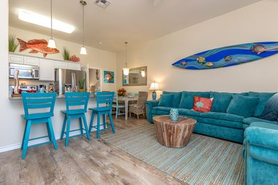 Living Room - Bright blue decor reminds you that the beach is just a half-mile away.