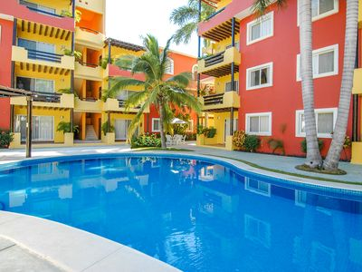 Photo for Beautiful Penthouse with mountain views & 5 minute walk to beach.