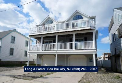 Photo for 3rd from the beach!! Fabulous Bonus Room with a Foose Ball table,TV with VCR & DVD, sectional sofa with a queen size sleeper sofa,slider to paved and fenced in back yard and outside shower!