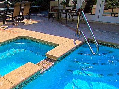 Large pool with jacuzzi that heats up in 20 min. Outdoor hot/cold shower