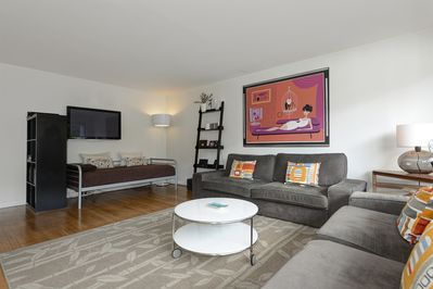 Living room with comfortable day bed under tthe 55 inch HD TV
