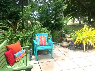 Photo for Peaceful oasis of tropical art & plants close to golf, beaches & shopping.