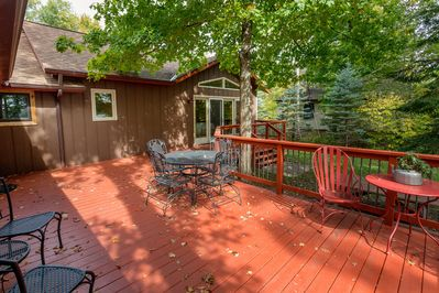 Deck has access from screen porch, side living room door, and master bedroom