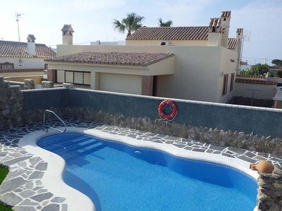 Photo for Air-Conditioned Apartment Close to the Beach with Pool, Terrace, Garden & Wi-Fi; Parking Available