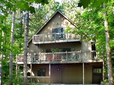 Photo for Stunning two-story home in the trees w/ a firepit, furnished deck, & balcony!