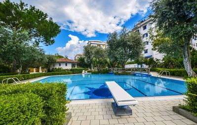 Photo for A few steps from the city center surrounded by lemon and orange trees with terrace and swimming pool
