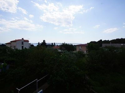 Photo for Holiday apartment with air conditioning, internet and sea view