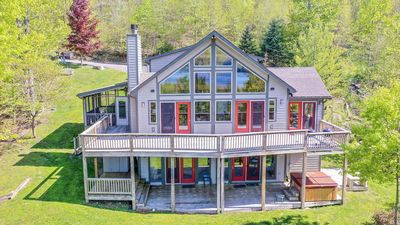 Photo for Big Lake & Mountain Views with a Hot Tub & Screened Porch Close to Wisp