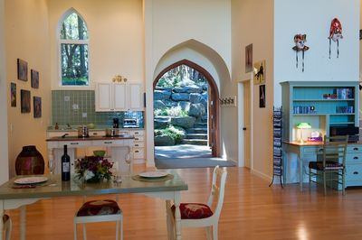View from the dining area with wide open front doors.