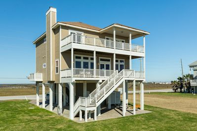 This view faces the beach. Upstairs deck have private doors to the deck.