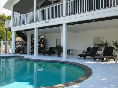 Photo for Fabulous Waterfront Island Vacation House!  Walk To Beach! Dock Your Boat! Heated Pool!