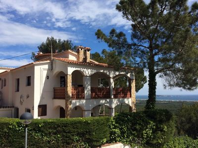 Photo for Holiday house in Pals with heated pool and nice sea view for up to 14 persons