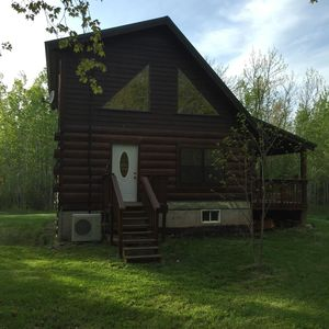 Photo for Serenity in a log home on 40 acres License TBES-ARDQ3A