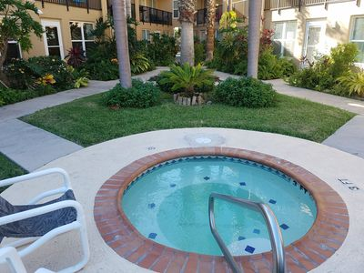 New well kept the hot tub in courtyard near107 front door. Gardens & Palm trees.