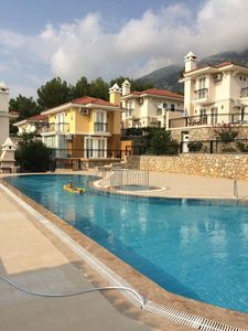 There is also another pool, the same size, just beyond the villas in the photo!