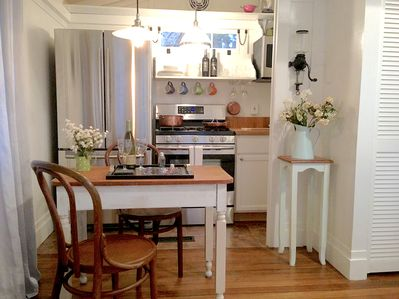 Antique French bistro table and chairs create a quaint European setting
