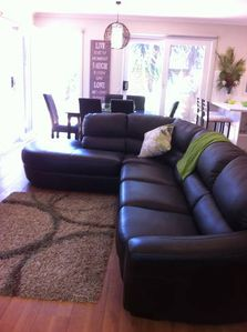 """Llounge/dining area """"The unit was comfortable & modern & so we enjoyed our stay"""