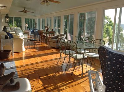 Here is the 44 foot porch where guests relax at Beckoning Bay Cottage