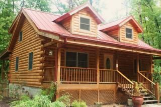 Photo for Log Cabin on 40 acres End Summer Special