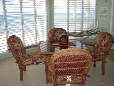 Screened-in Lanai with easy access to the beach and the pool.