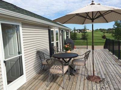 Patio furniture and view of 8th green
