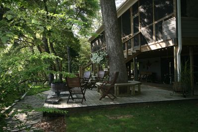 deck of main lodge & one of three fire pits available on property