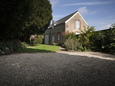Photo for 16th century Coach House Located within Beautiful Gardens