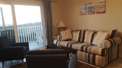 """Sleeper sofa, two comfy arm chairs.  There is also a 32"""" TV with Roku/Sling"""