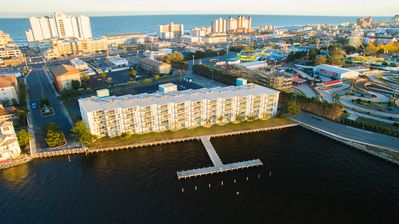 Photo for BAYFRONT!  4 BLOCKS to the BEACH!  32nd St!  BOAT DOCK!  PET FRIENDLY!  AMAZING!