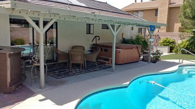Covered Patio with seating for 6 and large hot tub