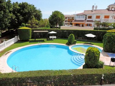 Photo for Overlooking Beautiful Communal Pool & 8 Minute Walk to Beach!!