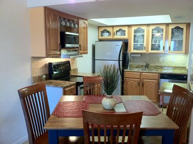 Custom kitchen w/granite counters, oak cabinets stainless appliances, pub table