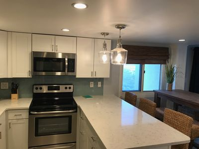 Newly updated kitchen with all new stainless appliances and quartz countertops