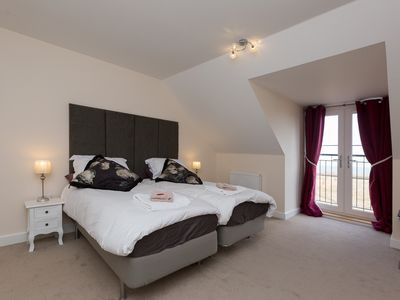 Photo for Gorgeous new build seaside facing townhouse 3 bedroom, private garden and parkin