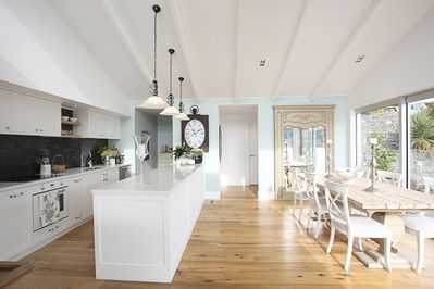 Beautiful kitchen and dining area - sliding doors open to the deck