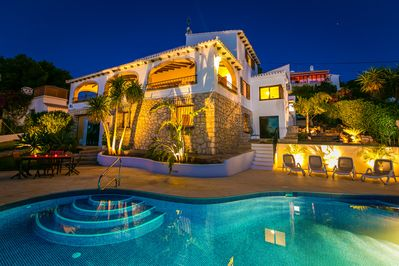 The house from the pool terrace at night