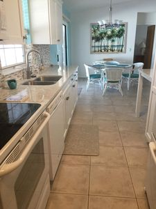 Beautiful kitchen fully stocked with everything you need. Table chairs different
