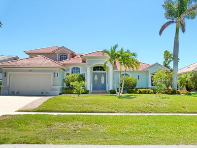 Photo for Captivating waterfront home w/ two master suites, heated pool & hot tub