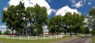 White picket fence surrounds this beautiful property. Gorgeous country setting!